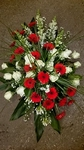 bloemstuk witte rozen gerbera langwerpig